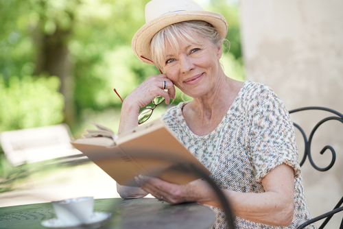 senior woman relaxing and reading a book